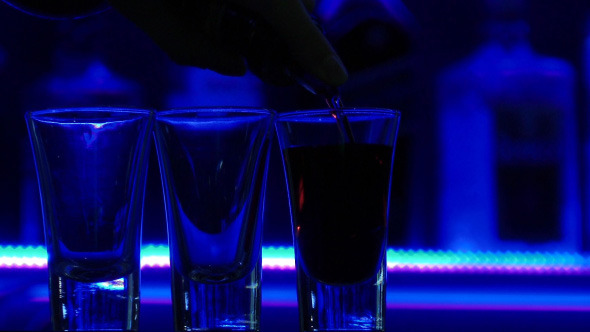 Pouring Three Shots of Clear Alcoholic Drink-3