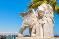 Winged Lion statue at Foinikoudes promenade. Larnaca. Cyprus - PhotoDune Item for Sale