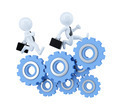 Business team running over cog wheel elements. Business concept. Isolated. Contains clipping path - PhotoDune Item for Sale