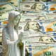 Praying statue with cash background - PhotoDune Item for Sale
