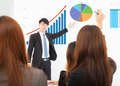 businessman giving a presentation about marketing sales in office - PhotoDune Item for Sale