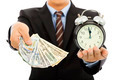 businessman holding money and clock. time is money concept in studio - PhotoDune Item for Sale