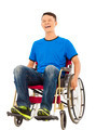 hopeful young man sitting on a wheelchair in studio - PhotoDune Item for Sale
