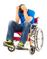 depressed  and handicapped man sitting on a wheelchair in studio - PhotoDune Item for Sale
