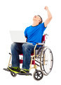 young man sitting on a wheelchair and  excited to raise arm in studio - PhotoDune Item for Sale