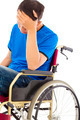 depressed handicapped man sitting on a wheelchair in studio - PhotoDune Item for Sale