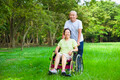 Asian senior woman sitting on a wheelchair with his husband in the park - PhotoDune Item for Sale
