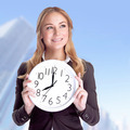 Happy businesswoman with big clock - PhotoDune Item for Sale