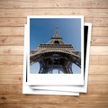 Eiffel Tower memory on photo frame brown wood plank background - PhotoDune Item for Sale
