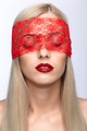 Woman face with eyes closed by red ribbon - PhotoDune Item for Sale