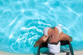 Woman Relaxing In The Swimming Pool - PhotoDune Item for Sale