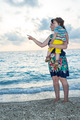 Mother with son pointing on beach - PhotoDune Item for Sale