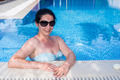 Woman relaxing in the pool - PhotoDune Item for Sale