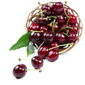 Fresh cherries in a wooden wicker basket. - PhotoDune Item for Sale