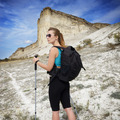 Young woman with backpack in mountains - PhotoDune Item for Sale