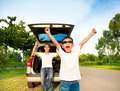 Happy children and father raise arms with their car in the park - PhotoDune Item for Sale
