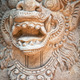 Muzzle of terrible mythical monster. Stone statue from Indonesia - PhotoDune Item for Sale