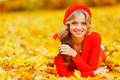 Woman laying on autumn leaves  - PhotoDune Item for Sale