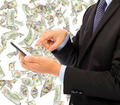 business man touching smart phone with money rain background - PhotoDune Item for Sale