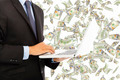 businessman holding a laptop with money rain background - PhotoDune Item for Sale