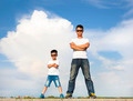Asian father and son standing on a stone platform with blue sky - PhotoDune Item for Sale