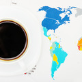 Coffee cup over world map and some kind of financial documents - view from top - 1 to 1 ratio - PhotoDune Item for Sale