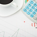 White coffee cup and calculator over some financial documents - view from top - 1 to 1 ratio - PhotoDune Item for Sale