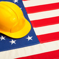 Yellow color construction helmet laying over USA flag - studio shoot - 1 to 1 ratio - PhotoDune Item for Sale