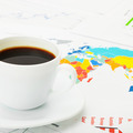 White coffee cup over world map and financial documents - 1 to 1 ratio - PhotoDune Item for Sale