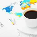 Coffee cup above world map and some documents - 1 to 1 ratio - PhotoDune Item for Sale