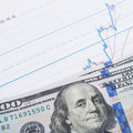 Stock market chart and 100 USA dollars over it - studio shot - 1 to 1 ratio - PhotoDune Item for Sale