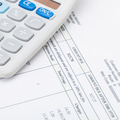 Studio shot of utility bill next to calculator - 1 to 1 ratio - PhotoDune Item for Sale