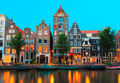 Night city view of Amsterdam canals and typical houses, Holland, - PhotoDune Item for Sale