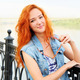 Smiling red haired women standing near river - PhotoDune Item for Sale