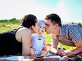 Young parents with baby outdoor in the park  - PhotoDune Item for Sale