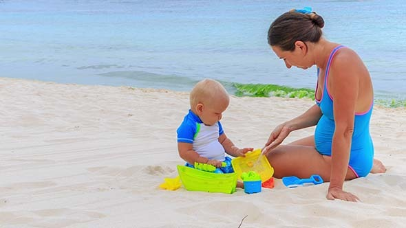 Baby and Mom Playing Beach Toys