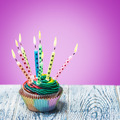 Birthday cupcake with burning candles - PhotoDune Item for Sale