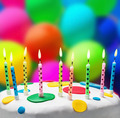 candles on a birthday cake on the background of balloons - PhotoDune Item for Sale