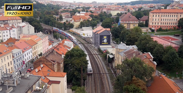 Passenger train pass over under the bridge in Prag