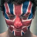 Happy man with British flag on face looking down - PhotoDune Item for Sale