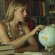 The Girl is Studying a Globe - VideoHive Item for Sale