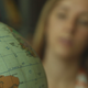 Girl Twists Globe - VideoHive Item for Sale