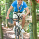 Man rides bicycle on tightrope at high rope course - PhotoDune Item for Sale