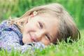 girl lying on grass smiling - PhotoDune Item for Sale