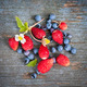 Berries on rustic wood background - PhotoDune Item for Sale