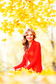 Woman sitting on autumn leaves - PhotoDune Item for Sale