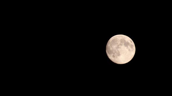 Full Moon Moving Across Night Sky