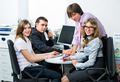 Teamwork of young pretty businessmen works on project in office - PhotoDune Item for Sale