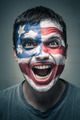 Exited man with US flag painted on face - PhotoDune Item for Sale
