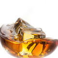 Splash of whiskey with ice in glass isolated on white background - PhotoDune Item for Sale